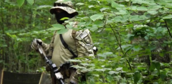 Paramilitary-style guards 'are going to stay,' mining company vows
